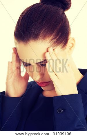 Young businesswoman suffering a headache
