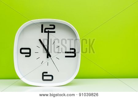 White Clock On Light Green Background