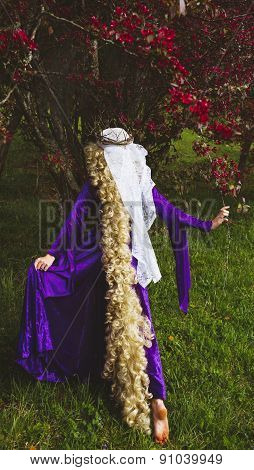 Woman dressed as the fairy tale character, Rapunzel