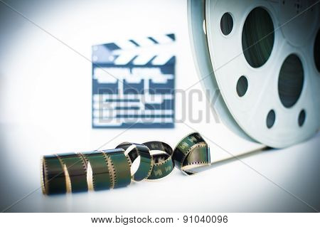 Movie Clapper And 35 Mm Film Roll On White