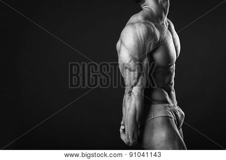 Muscular man bodybuilder. Man posing on a black background, shows his muscles