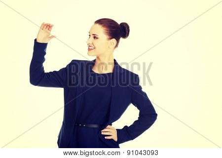 Business woman showing something or copyspase for product or sign text