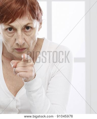 Sixty years woman  pointing with finger