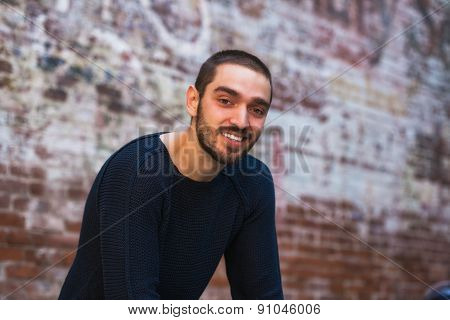 Handsome Smiling And Casual Young Man Looking Towards