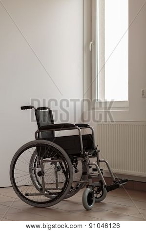 Wheelchair In Empty Room