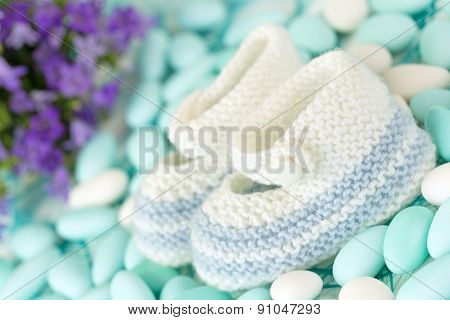 wool baby shoes on candies