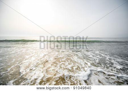 Foam waves on the beach