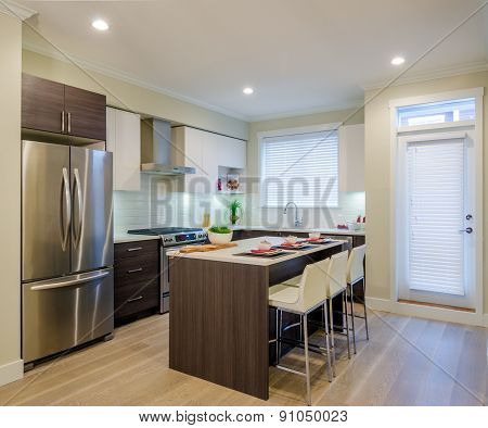 Modern kitchen interior with island and cabinets in a luxury house