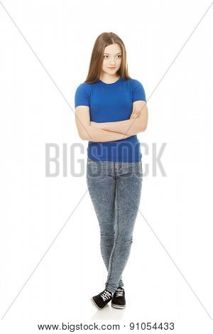 Young confident woman with crossed arms.
