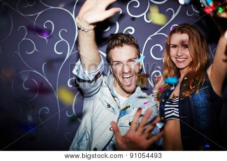 Ecstatic couple having fun at party