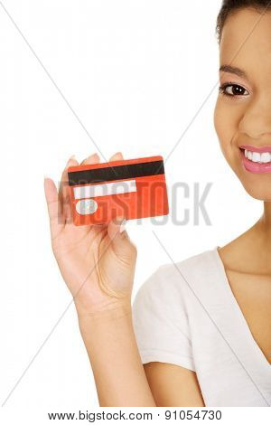 African woman holding a credit card.