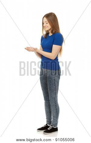 Teenage woman with open hands
