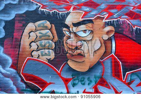 Street art Montreal strong man