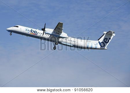 Amsterdam Airport Schiphol - Bombardier Dash 8 Of Flybe Takes Off
