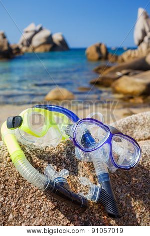 Diving goggles on sea beach