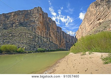 River Flowing Through A Desert Canyon
