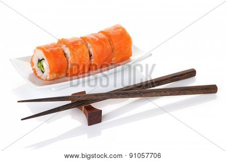 Shrimp sushi and chopsticks. Isolated on white background