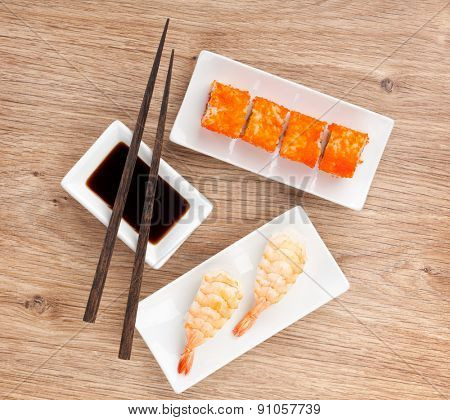 Sushi maki and shrimp sushi on wooden table background