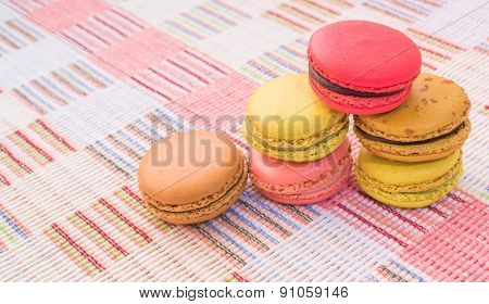Sweet And Colourful French Macaroons On Cotton Cloth Background.