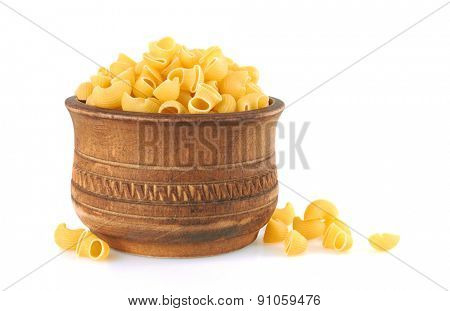 Macaroni italian pasta in wood bowl, isolated on white background