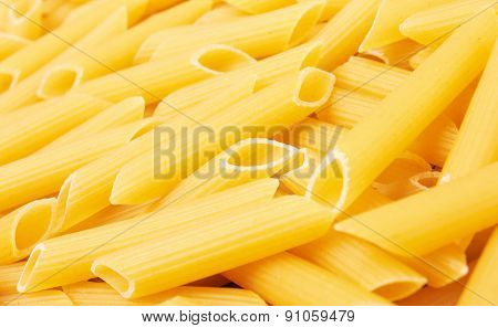 Penne italian pasta background, close up