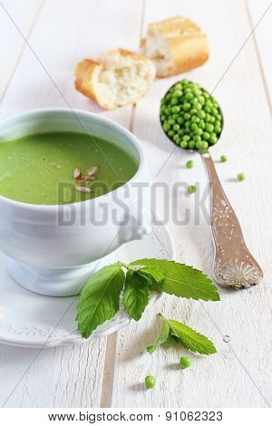 Minty Pea Soup And Baguette On A Light Background
