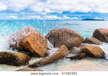 Wave on the rocks. The Seychelles