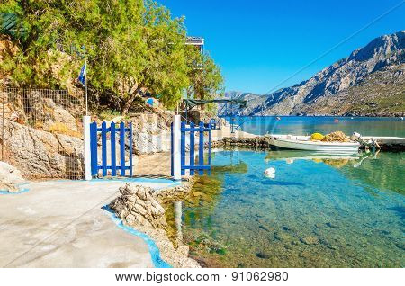 Small port with blue wooden gate, Greece