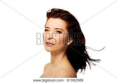 Beautiful caucasian spa woman with wind in hair.