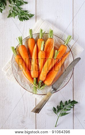 Fresh Peeled Carrots On Green Tops