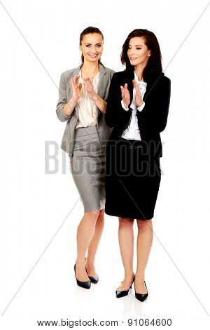 Two happy cheerful businesswomen applauding.
