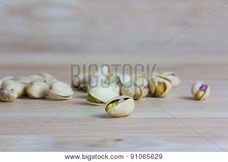 Close Up Pistachios On Wooden Background