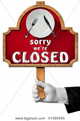 Sorry We Are Closed -  Sign With Hand Of Waiter