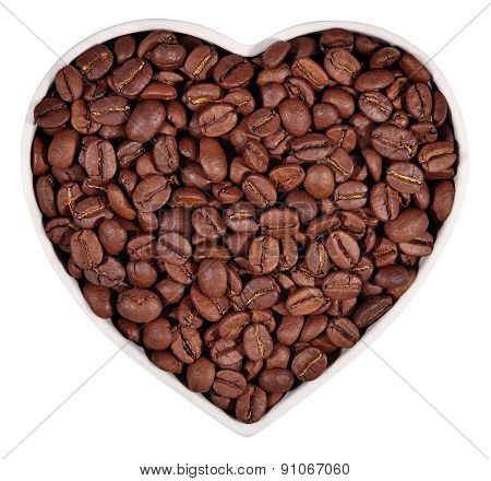 Coffee Beans In Plate In The Form Of Heart On A White