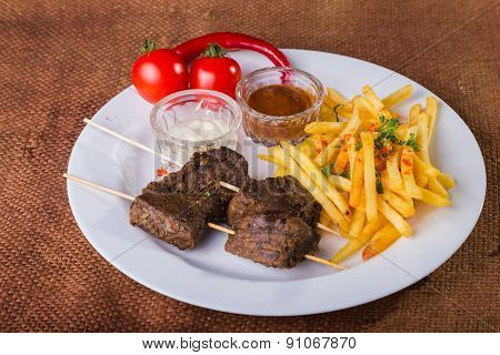 Delicious food. Meat with fries. Eastern food