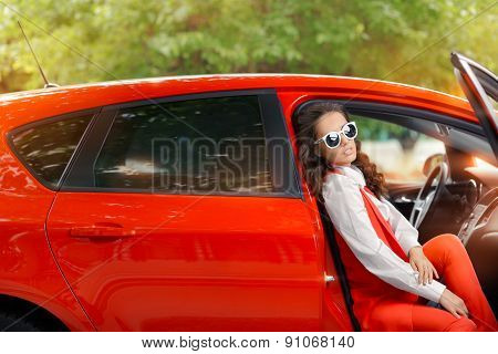 Elegant Beautiful Woman in Red Car