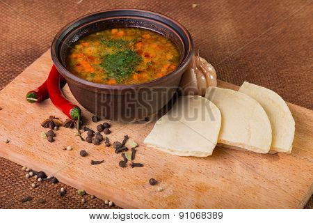 Oriental soup. Eastern food. Arab food. Soup with bread.