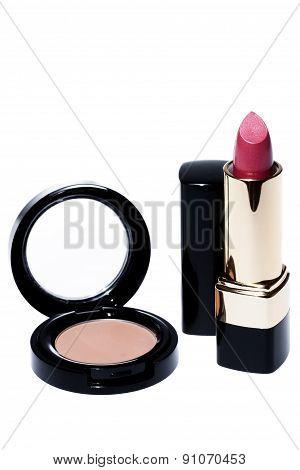 Lipsticks And Eye-shadows Isolated White Background