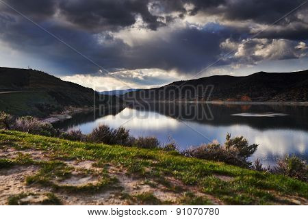 echo reservoir in utah with dramatic clouds