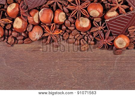 Coffee, Chocolate, Star Anise And Hazelnuts On A  Wooden