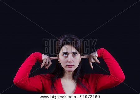Stressed young women,student portrait, sad, bothered, holding hand on her head isolated on black