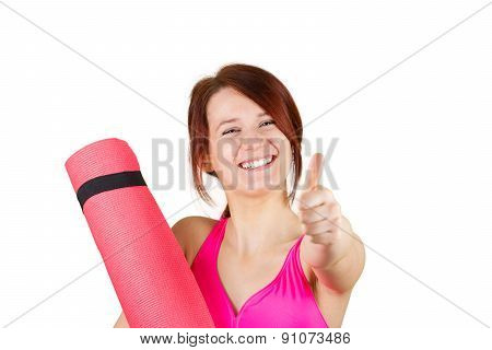 Sporty fit healthy smiling beautiful woman, red head girl holding  an yoga mat and thumb up.Exercise