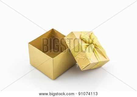 Golden Gift Box With Ribbon Bow .