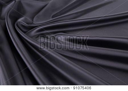 Black silk drapery.
