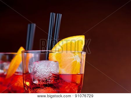 Glasses Of Spritz Aperitif Aperol Cocktail With Orange Slices And Ice Cubes With Space For Text