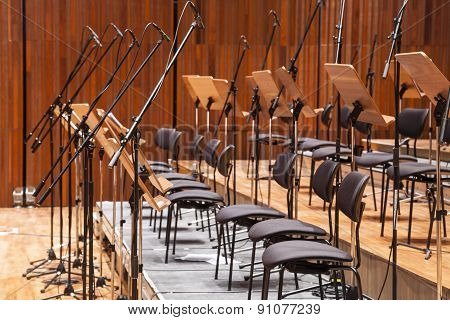 Orchestra Stage With Chairs And Microphone In Row