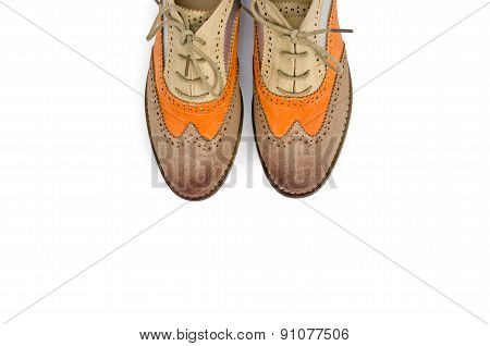 Beautiful brown and orange woman shoes isolated on white backgro