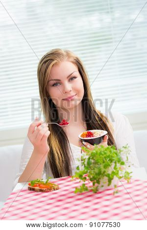 Young Woman Is Eating Snack
