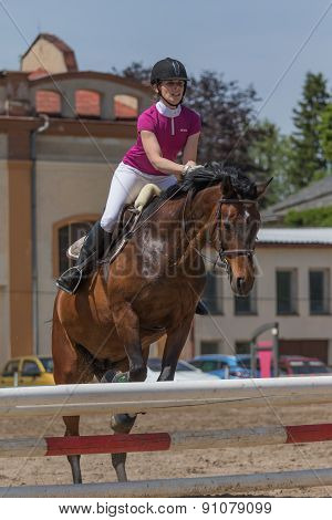 Young Horsewoman In Action. Vertically.