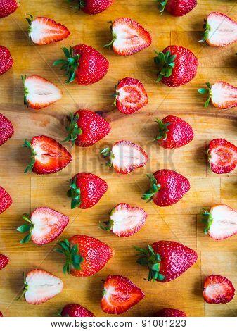 Arranged Pattern Of Strawberries On A Wooden Board